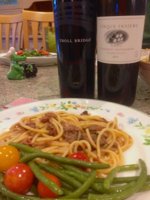 Two red wines, one pasta dish